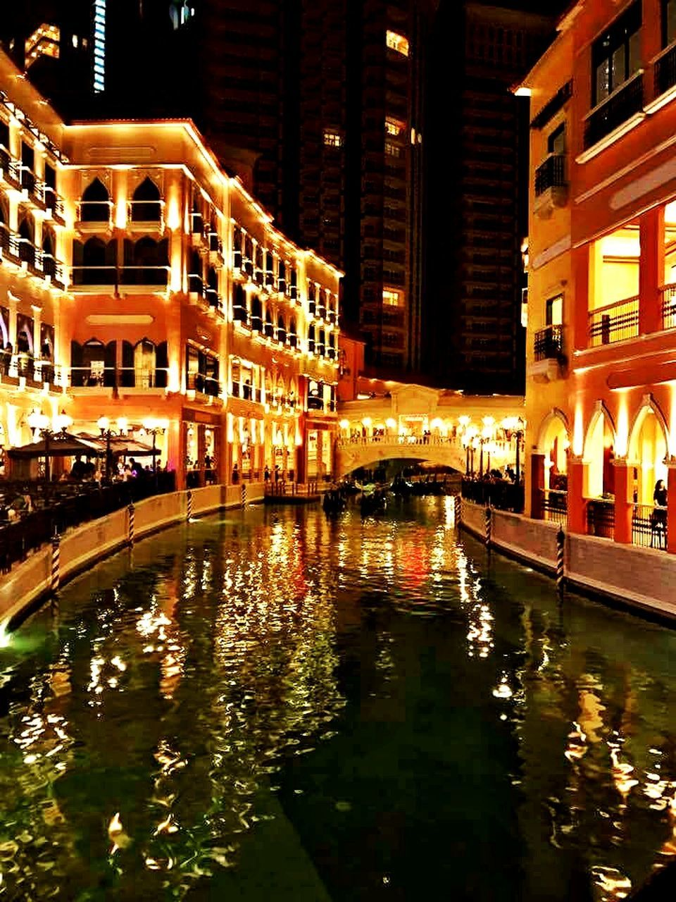 architecture, building exterior, night, built structure, illuminated, reflection, waterfront, water, city, outdoors, no people, modern, nature, sky