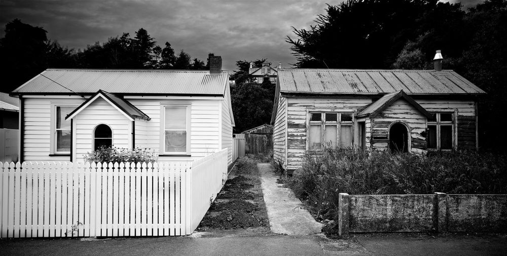 Two old houses, Mataura, NZ Building Exterior Built Structure Footpath House Mataura NZ No People Old Buildings Old Houses Overgrown Garden Tidy Old House Untidy Old House Untidy Section