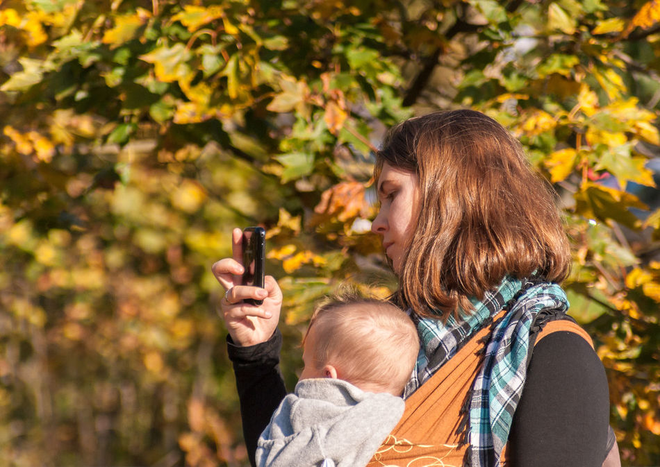 Remembering the Old City of Vilnius Autumn Baby Baby Sling Baby Wrap Babywearing Bonding Childhood Children Family Leaves Leisure Activity Lifestyle Love Maternity Mom Mother Mother And Son Motherhood Outdoors Parenting Real People Taking Photos Togetherness Woman Mobile Conversations