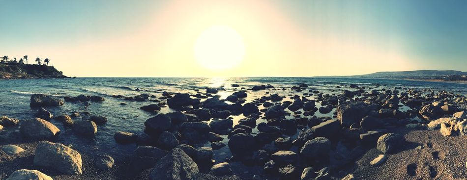 Sea Horizon Over Water Nature Beach Beauty In Nature Scenics Tranquil Scene Sunset Tranquility Water Sky Sunlight Rock - Object Sun No People Outdoors Clear Sky Day Pebble Beach