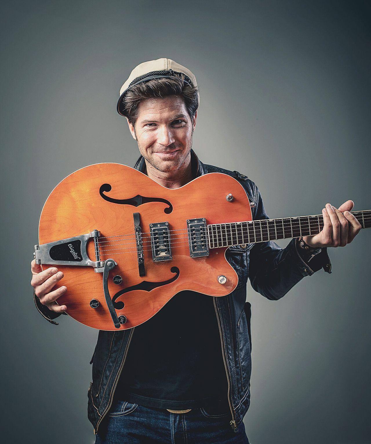 Portrait Guitar Portrait Of A Man  Hat Orange Color Fashion Leather Jacket Studio Shot