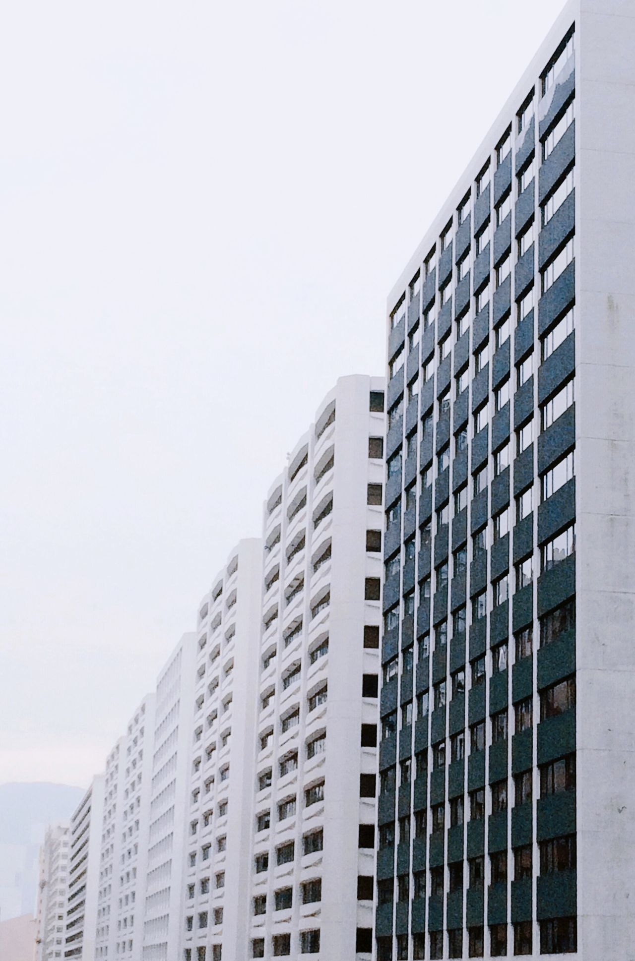 Architecture Building Exterior Skyscraper Built Structure City Minimalism White Perspective HongKong No People Window Modern Low Angle View Day Outdoors