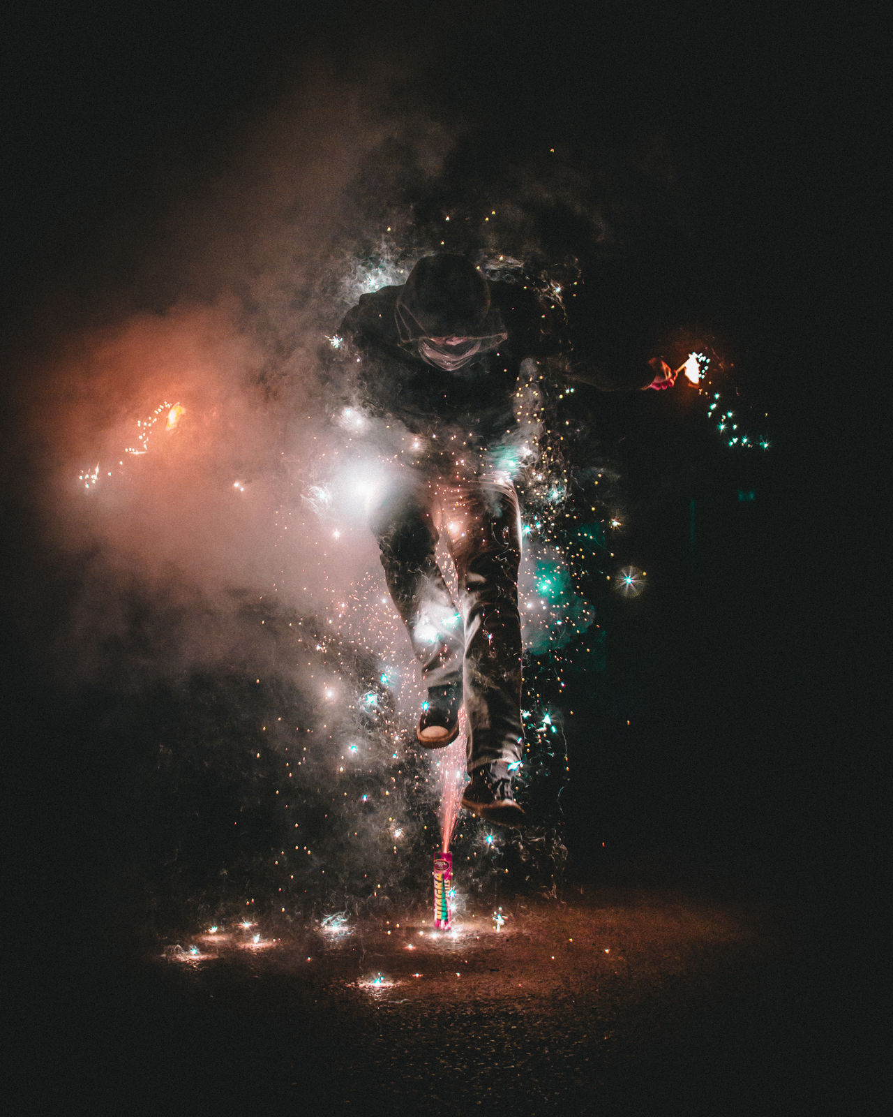 Fireworker night illuminated sky Celebration no people outdoors Event firework - man made object star - space Galaxy young adult photographer City sparks sparks flying