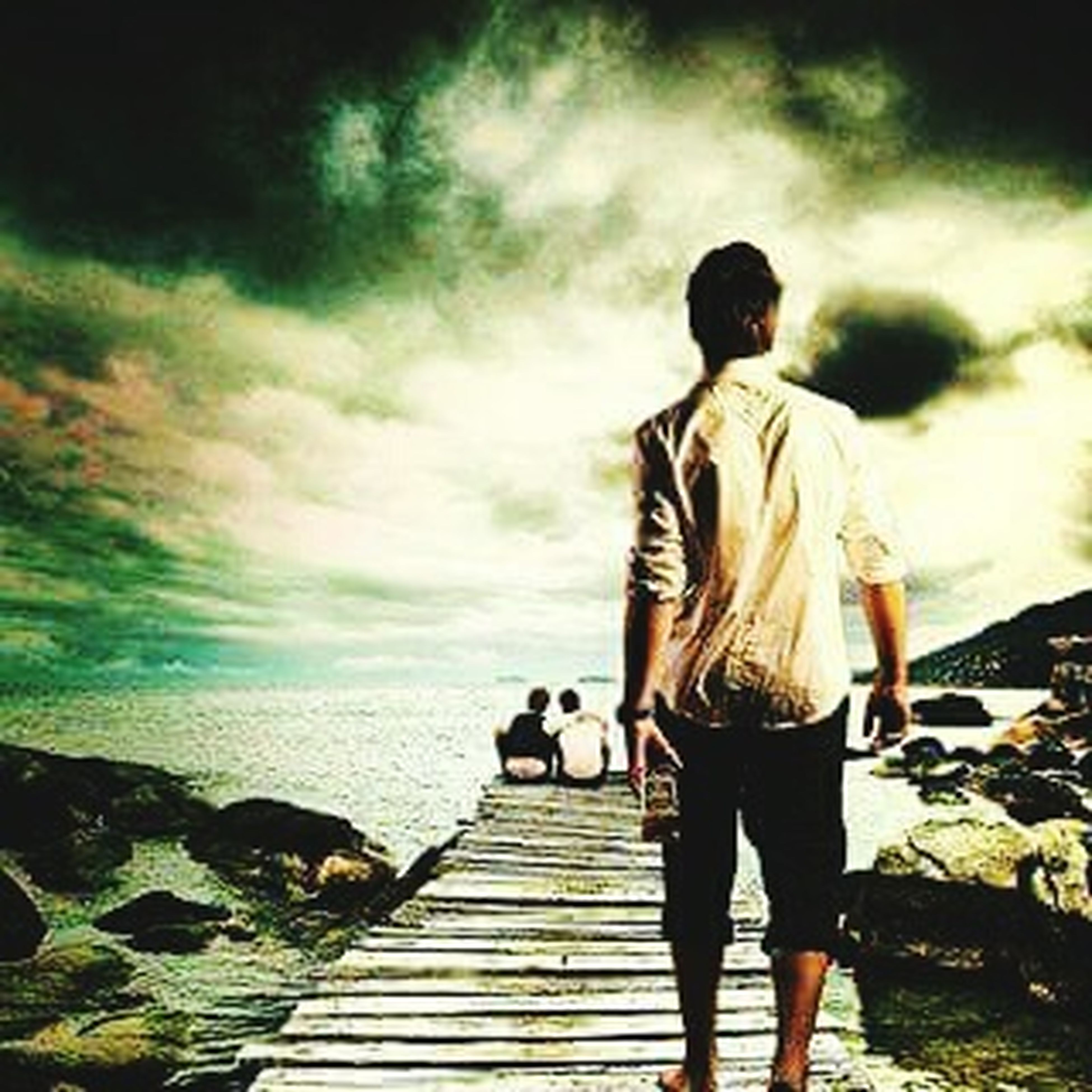 lifestyles, rear view, full length, sky, leisure activity, men, sea, standing, cloud - sky, water, casual clothing, togetherness, person, walking, cloud, nature, bonding