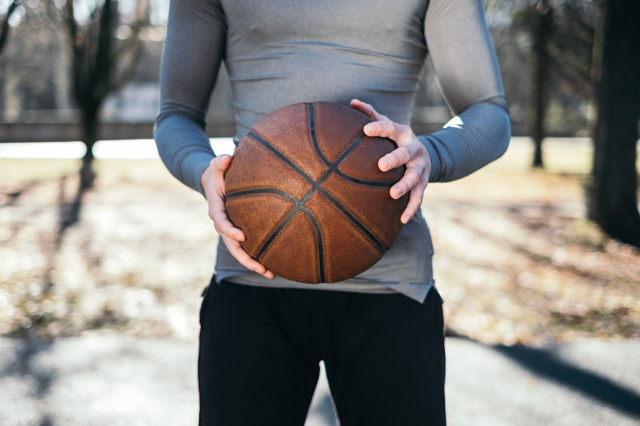 man playing basketball Adult Adults Only Athlete Basketball - Sport Exercising Healthy Lifestyle Human Body Part Lifestyles Midsection One Man Only One Person Outdoors People Sport Sports Clothing Sports Training Sportsman Young Adult