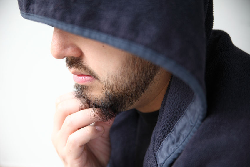 Man in hoodie profile Bearded Black Hoodie Close-up Fingers Hand Human Face Indoors  Jacket Natural Light One Person Pensive Portrait Profile Serious Expression Thinking Thoughtful Warm Clothing Young Men