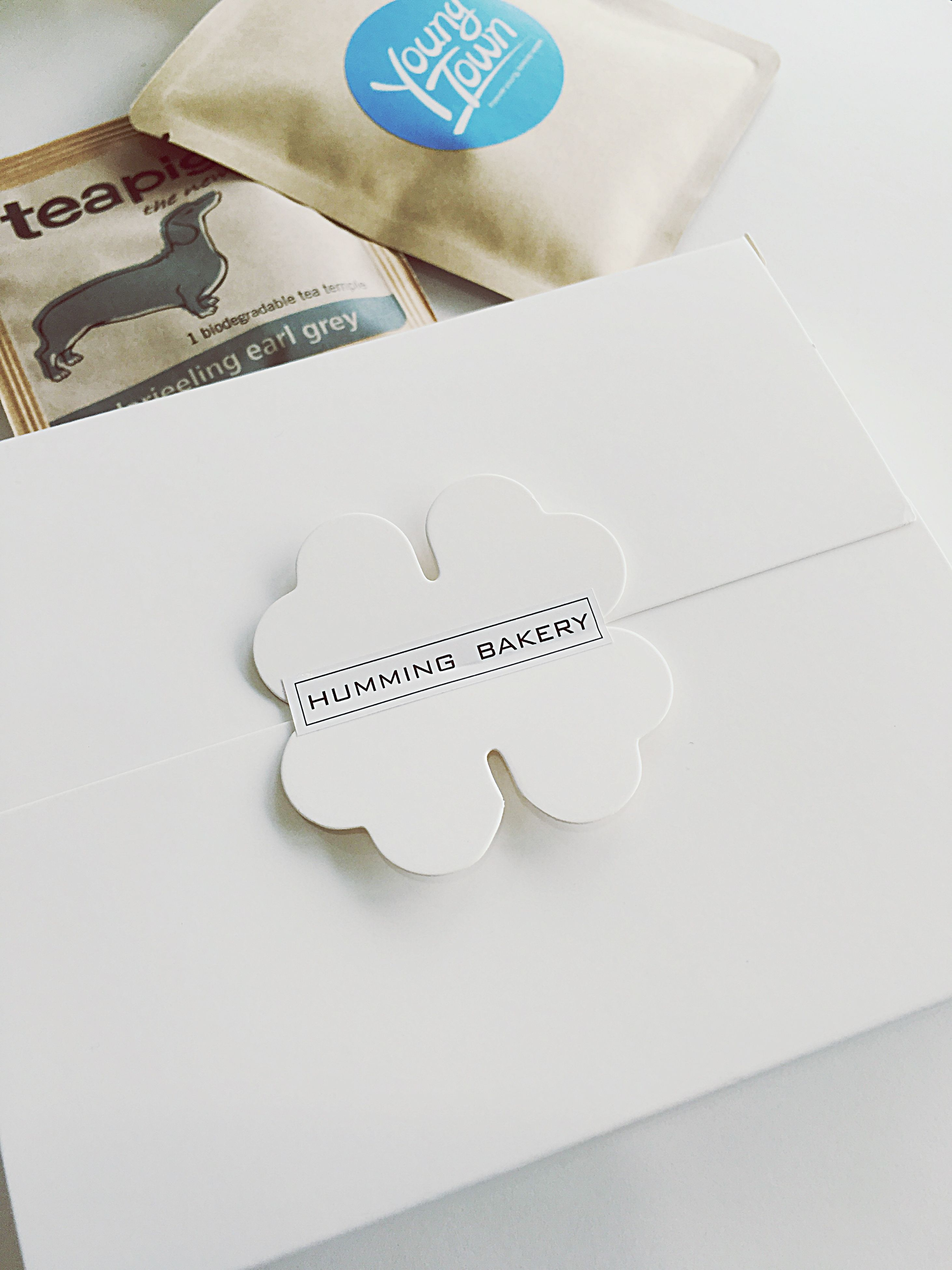indoors, still life, text, paper, communication, high angle view, table, western script, close-up, white color, creativity, heart shape, art and craft, book, no people, education, art, studio shot, love, ideas