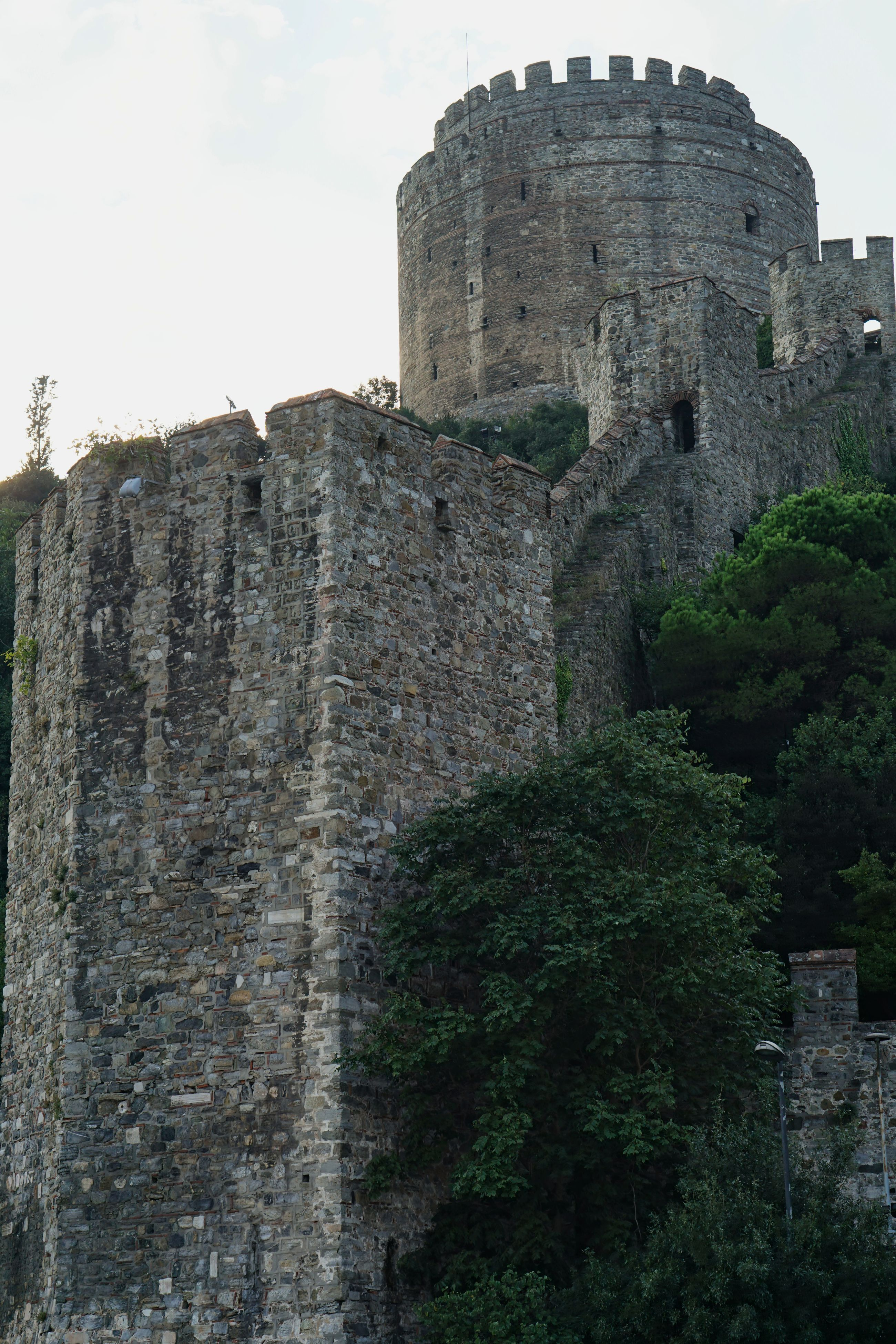 built structure, architecture, history, the past, sky, wall - building feature, building exterior, old ruin, castle, low angle view, rock - object, fort, ruined, weathered, damaged, deterioration, outdoors, fortified wall, stone material, ancient, ancient civilization, medieval, archaeology, tourism, obsolete, cloud - sky