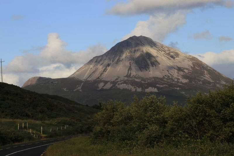 Mount Errigal Beauty In Nature Cloud - Sky Day Erupting Geology Mount Errigal. Ireland. Mountain Natural Disaster Nature No People Outdoors Scenics Sky Smoke - Physical Structure Travel Destinations Tree Volcano