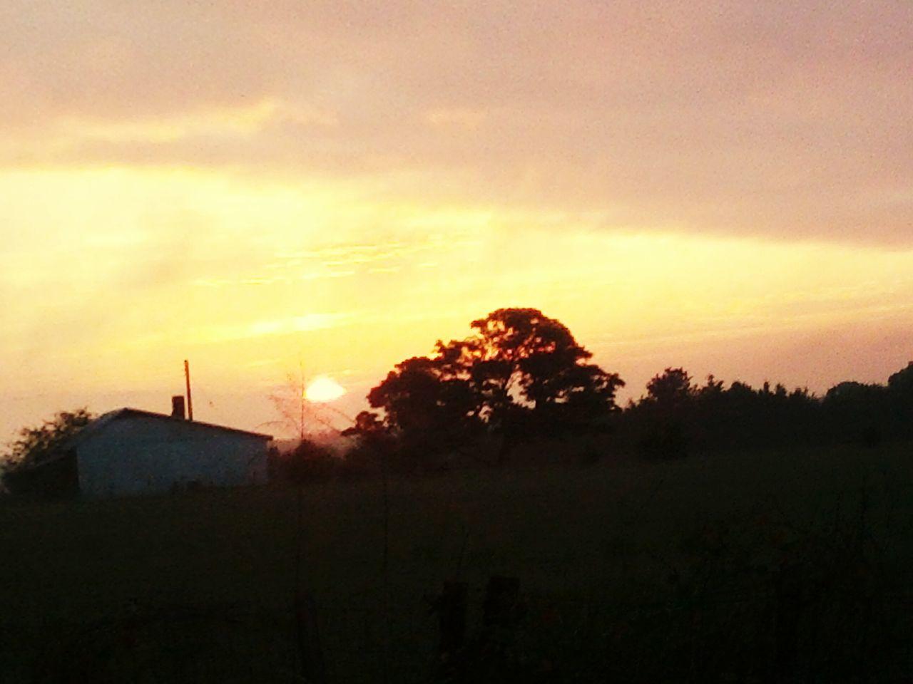 Early Sunrise Behind Old Farm House
