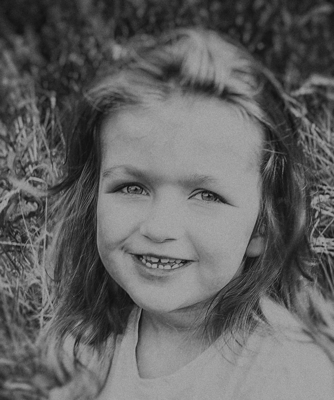 looking at camera, portrait, childhood, one person, smiling, girls, real people, happiness, close-up, headshot, blond hair, human face, day, outdoors, child, young adult, people