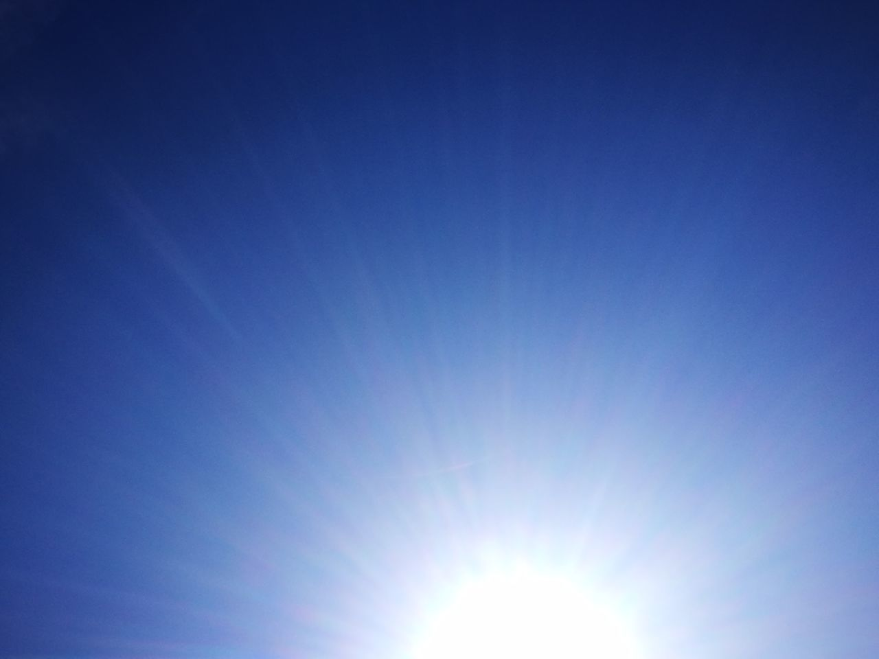 sun, sunbeam, blue, sunlight, bright, clear sky, nature, beauty in nature, scenics, no people, sky, outdoors, day, space, vapor trail, astronomy
