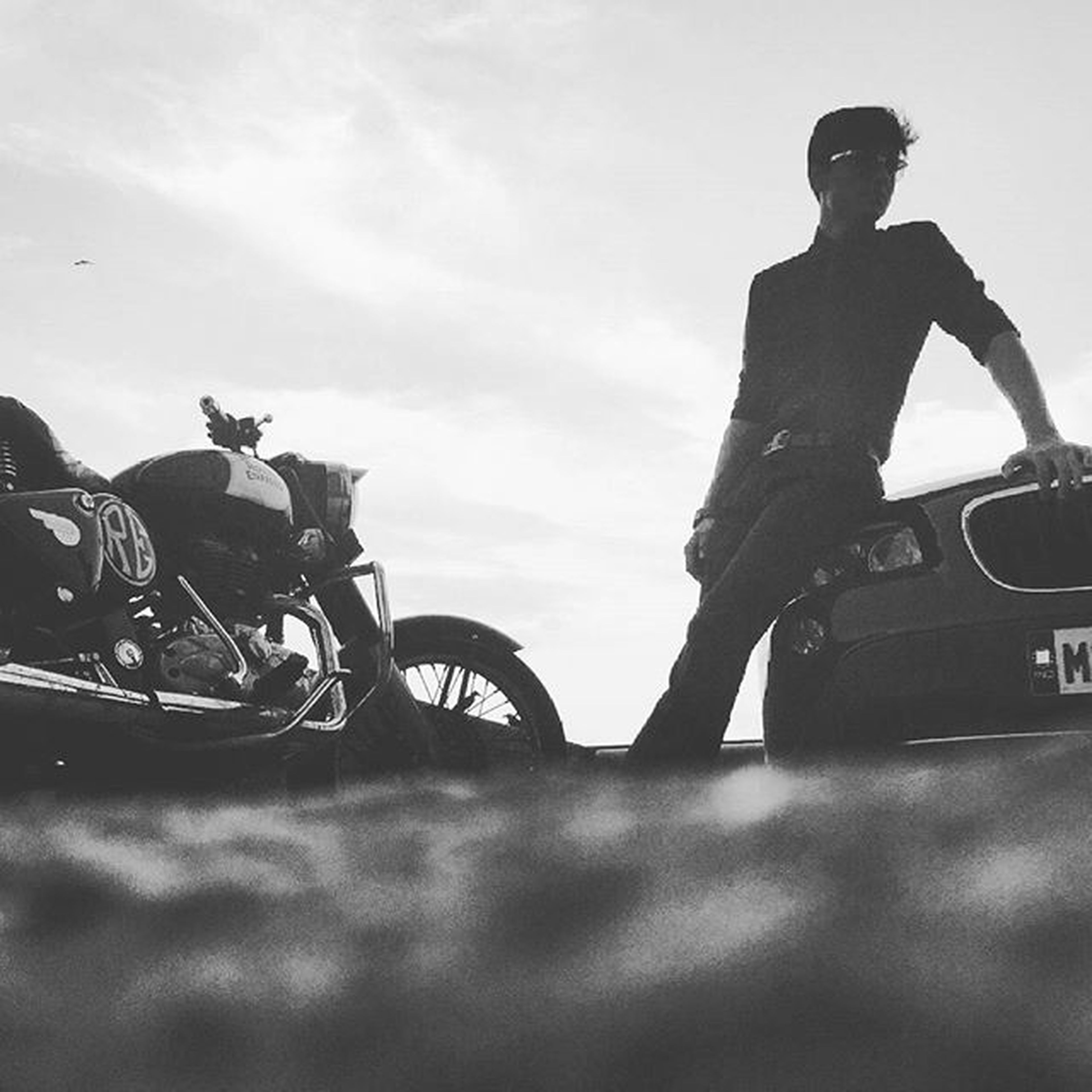 transportation, land vehicle, men, bicycle, mode of transport, lifestyles, sky, leisure activity, riding, side view, cycling, outdoors, holding, full length, day, motorcycle, silhouette