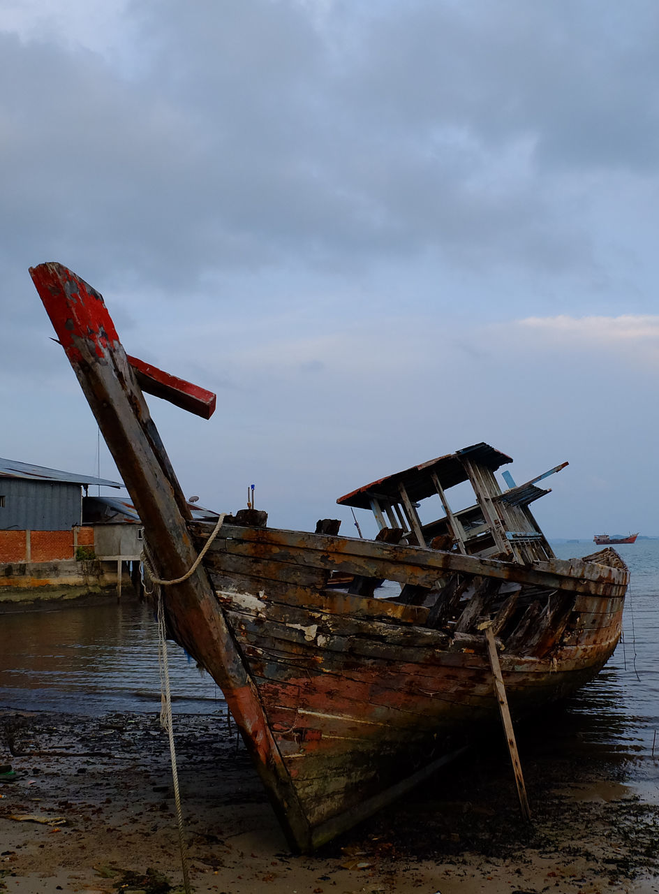 nautical vessel, abandoned, water, damaged, obsolete, sky, sea, transportation, run-down, no people, nature, rusty, cloud - sky, sinking, moored, outdoors, day, sunken