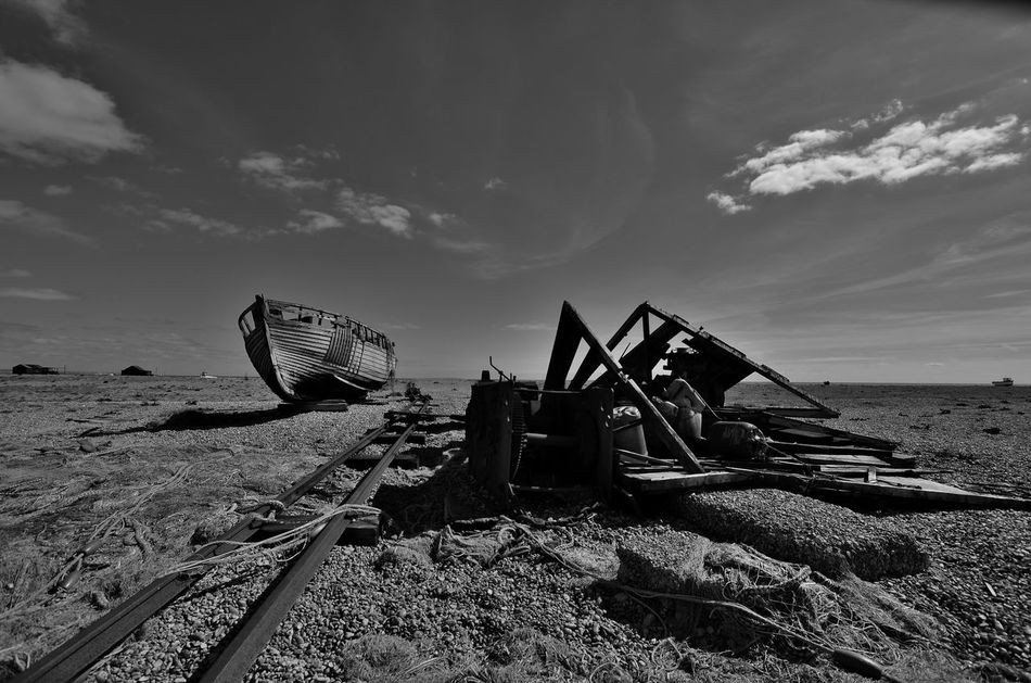 Beach Beachlife Black And White Boat Cloud - Sky Coastal Desolate Dungeness Forgotten Forgotten Places  Junk No People Past Prehistoric Seaside Tracks Broken Wooden Texture Fishing Boats Pebble Beach Deserted The Past Fishermanslife Old Boat Fishing Boat
