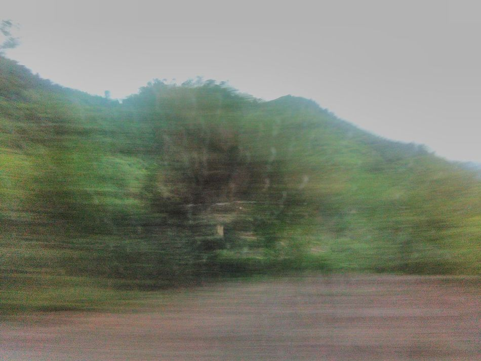 # At a GR8 sPEED @ FORTUNER Beauty In Nature Blurred Motion Empty Road Lush Foliage Mountain Mountain Range Non-urban Scene Outdoors Remote