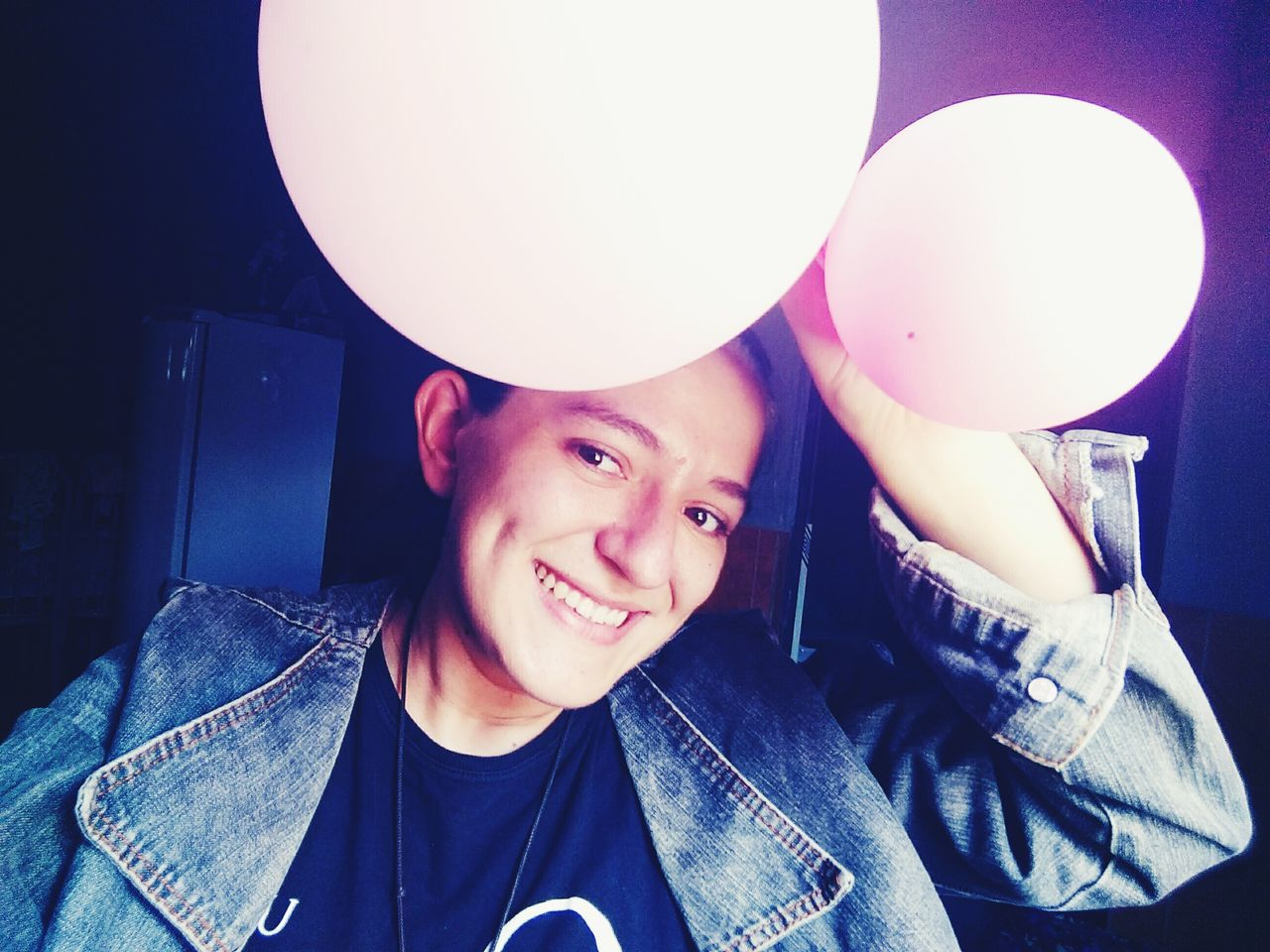 casual clothing, one person, real people, looking at camera, front view, portrait, head and shoulders, young adult, leisure activity, balloon, smiling, happiness, young men, boys, lifestyles, childhood, indoors, night, close-up