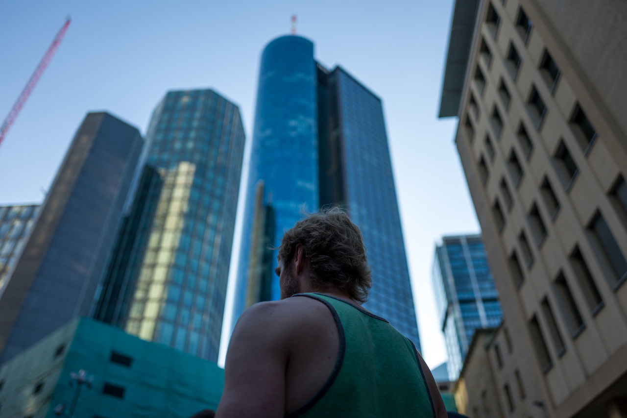 Frankfurt Adult Architecture Building Exterior Built Structure City Cityscape Clear Sky Day Downtown District Low Angle View Men Modern One Person Outdoors People Real People Rear View Sky Skyscraper Urban Skyline