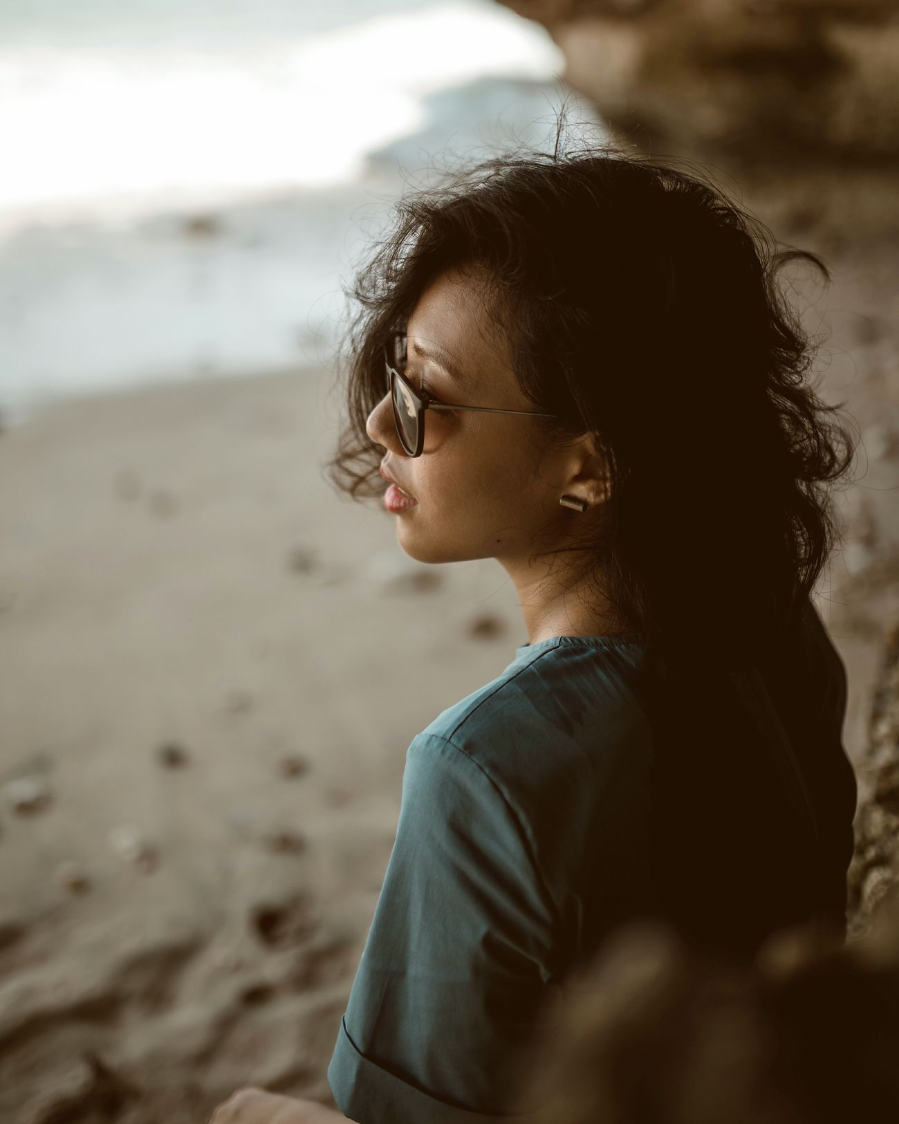 lay my soul in unnamed rivers Close-up Beach One Woman Only Portrait Of A Woman Portrait Of A Girl Portraits Of EyeEm Portrait Women Of EyeEm Natural Light Portrait Beautiful People Light Light And Shadow Sunglasses Curly Hair Side Profile Women Around The World