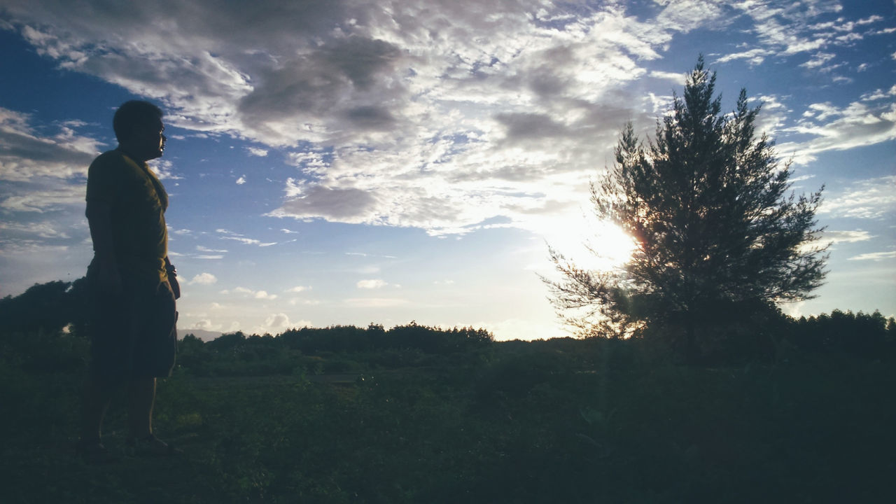 Silhouette Cloud - Sky Nature Sky Rural Scene Outdoors Field Landscape People One Person Adult Sunset Tree One Man Only Day Only Men Men Grass Adults Only Beauty In Nature EyeEmNewHere