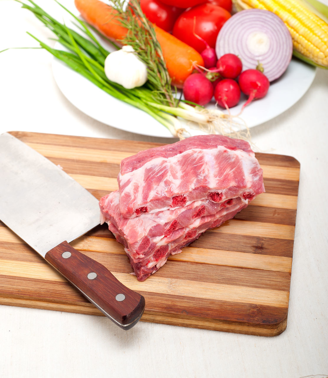 Meat Slice With Vegetables In Plate On Table