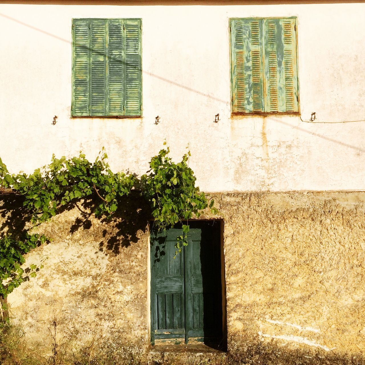 House face. Kefalonia, Greece. Photo by Tom Bland. Building Exterior Built Structure House No People Outdoors Travel Photography Hellas Travel IPhoneography IPhone Face Faces Of EyeEm Faces Exterior Houses Houses And Windows Home Greece Greek House Villa Façade Kefalonia, Greece Kefalonia Property Real Estate