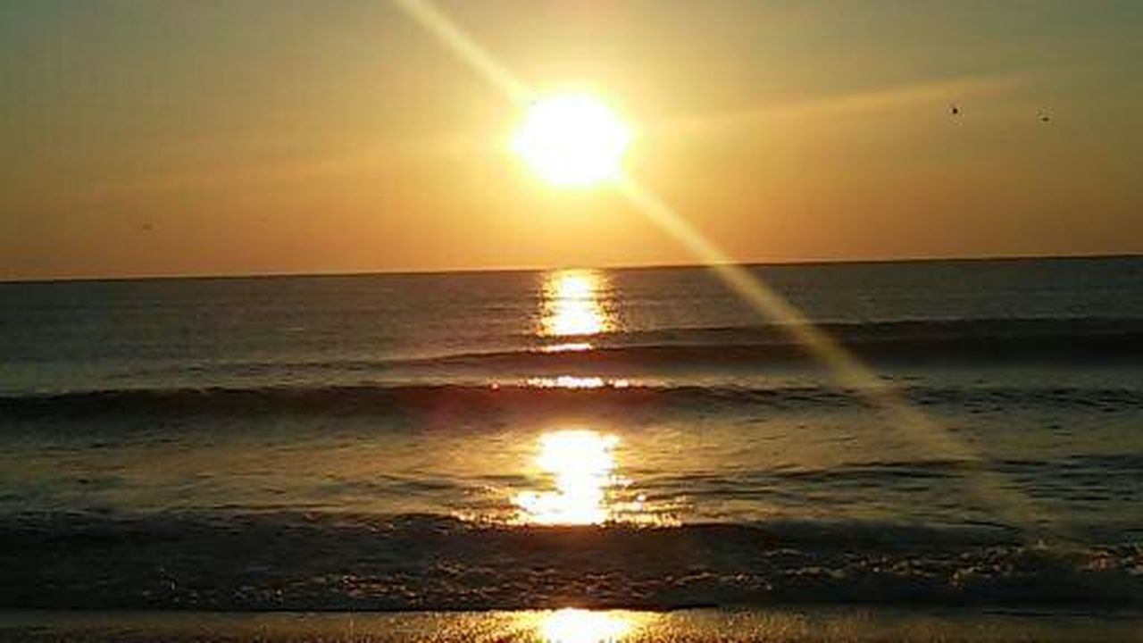 sun, sunset, sea, sunlight, reflection, beauty in nature, sunbeam, nature, scenics, water, orange color, horizon over water, tranquil scene, tranquility, bright, sky, outdoors, vibrant color, idyllic, beach, brightly lit, no people, silhouette, awe, summer, wave, refraction, day