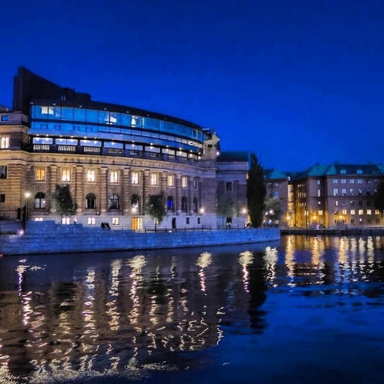 night, illuminated, architecture, reflection, building exterior, built structure, blue, travel destinations, arts culture and entertainment, dusk, history, travel, city, sky, outdoors, water, no people, cityscape, urban skyline