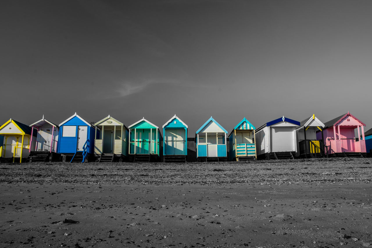 Beach Huts at Southend On Sea in the UK Beach Beach Hut Beach Huts Black & White Black And White Photography Blackandwhite Day Hut Huts In A Row Multi Colored No People Outdoors Sand Sea Selective Color Sky Southend Southend On Sea Summer Vacations First Eyeem Photo