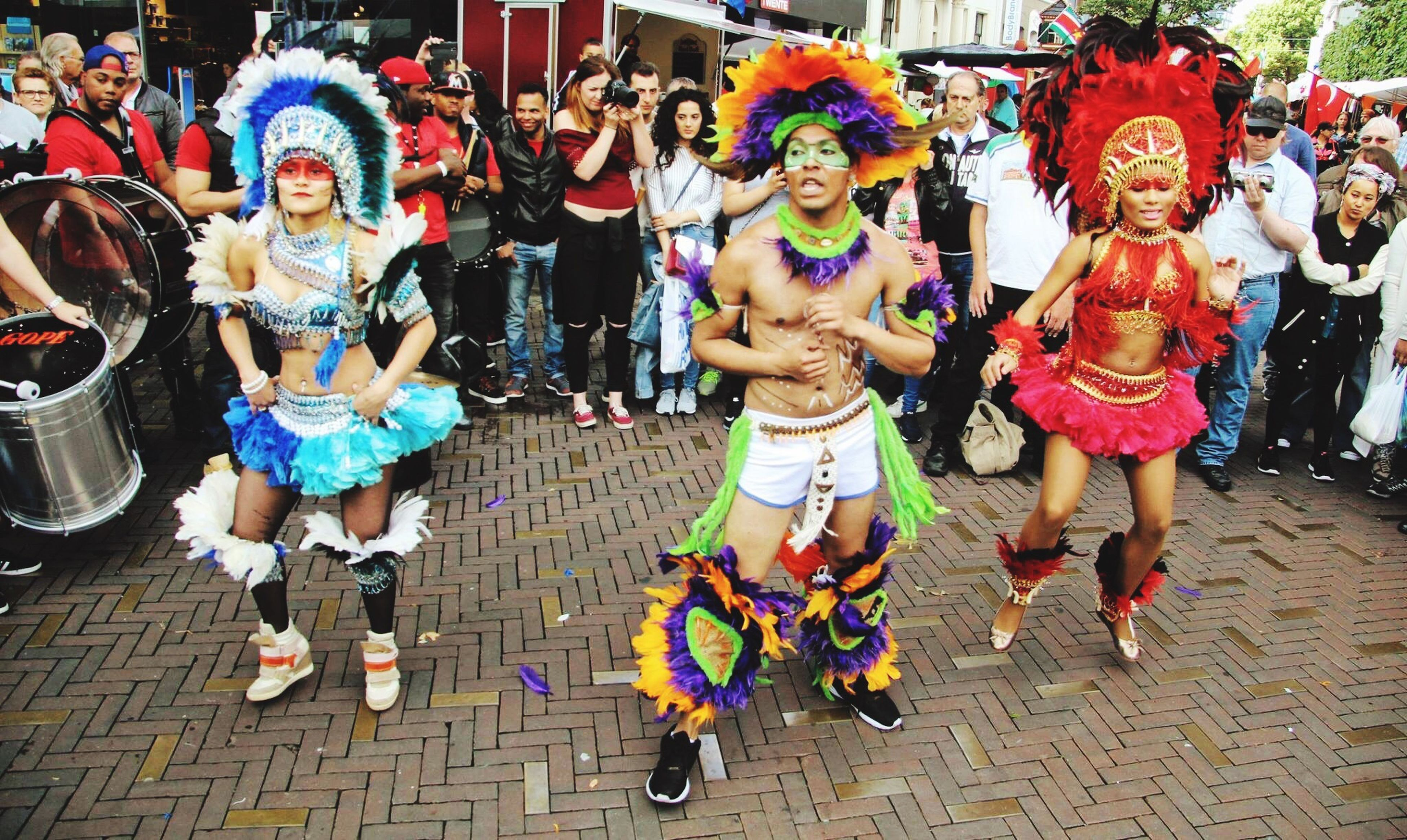 full length, lifestyles, arts culture and entertainment, outdoors, people, day, flexibility, crowd, clown, adult