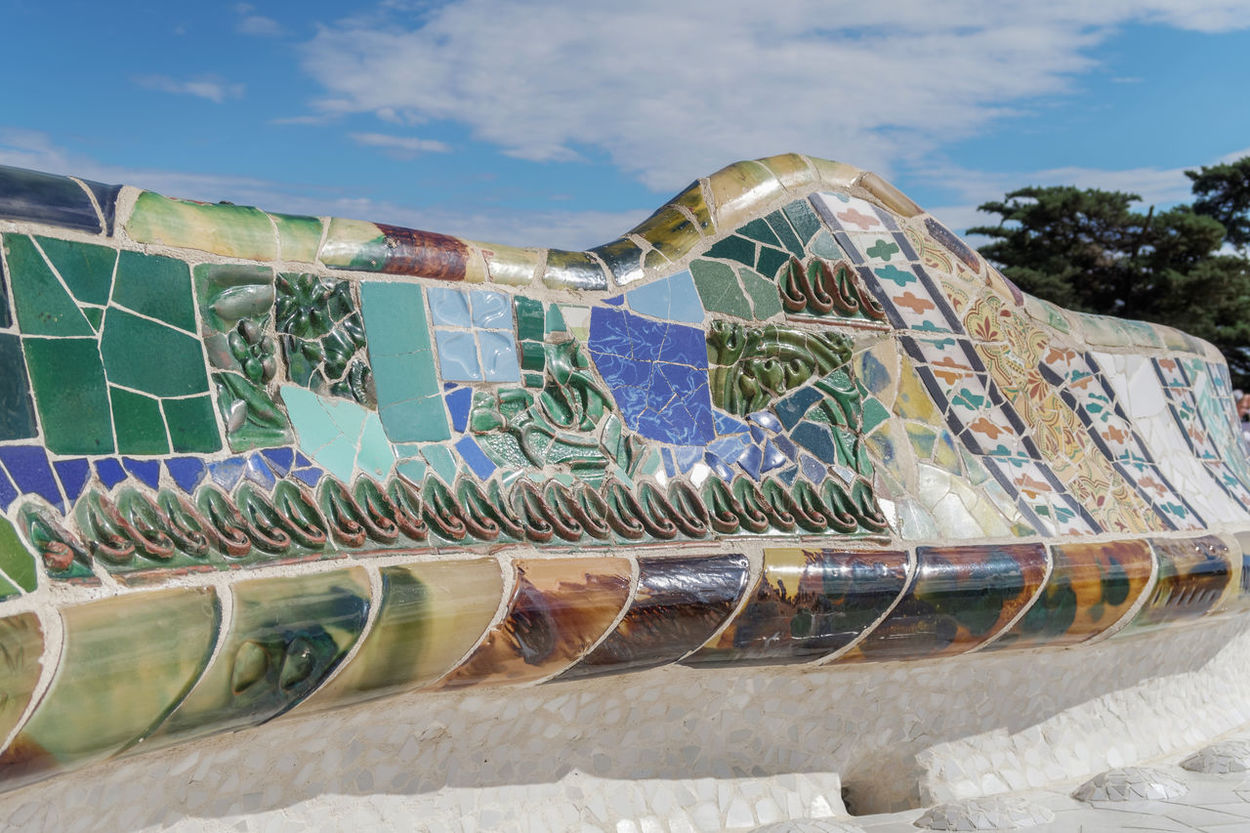 Barcelona, Spain Park Guell mosaic seating at Nature Square Placa de la Natura. Mosaic seating area with multi-coloured tiles at at Nature Square Placa de la Natura. Amusement Park Antoni Gaudí Architecture Attraction Attraction Park Barcelona Barcelona, Spain Catalonia Ceramic Day Gaudi Guell Guell Monumental Zone No People Outdoors Park Guell Park Güell, Barcelona SPAIN Spanish Spanish Arquitecture Travel Travel Destinations Traveling Urban Urban Geometry