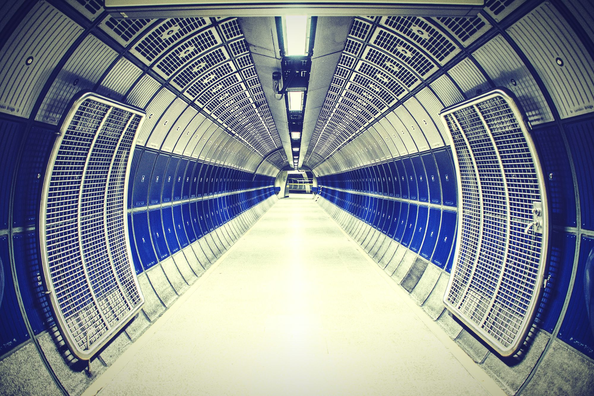 Walking the halls of The Death Star or just London Underground. Empty Long Flooring Built Structure Ceiling Transportation Architecture Narrow Surface Level Modern Walkway Pathway Diminishing Perspective Tunnel Pedestrian Walkway Underpass Arched Paulkennedyphotography Tourism City Life Deathstar Deathststar Star Wars London Underground