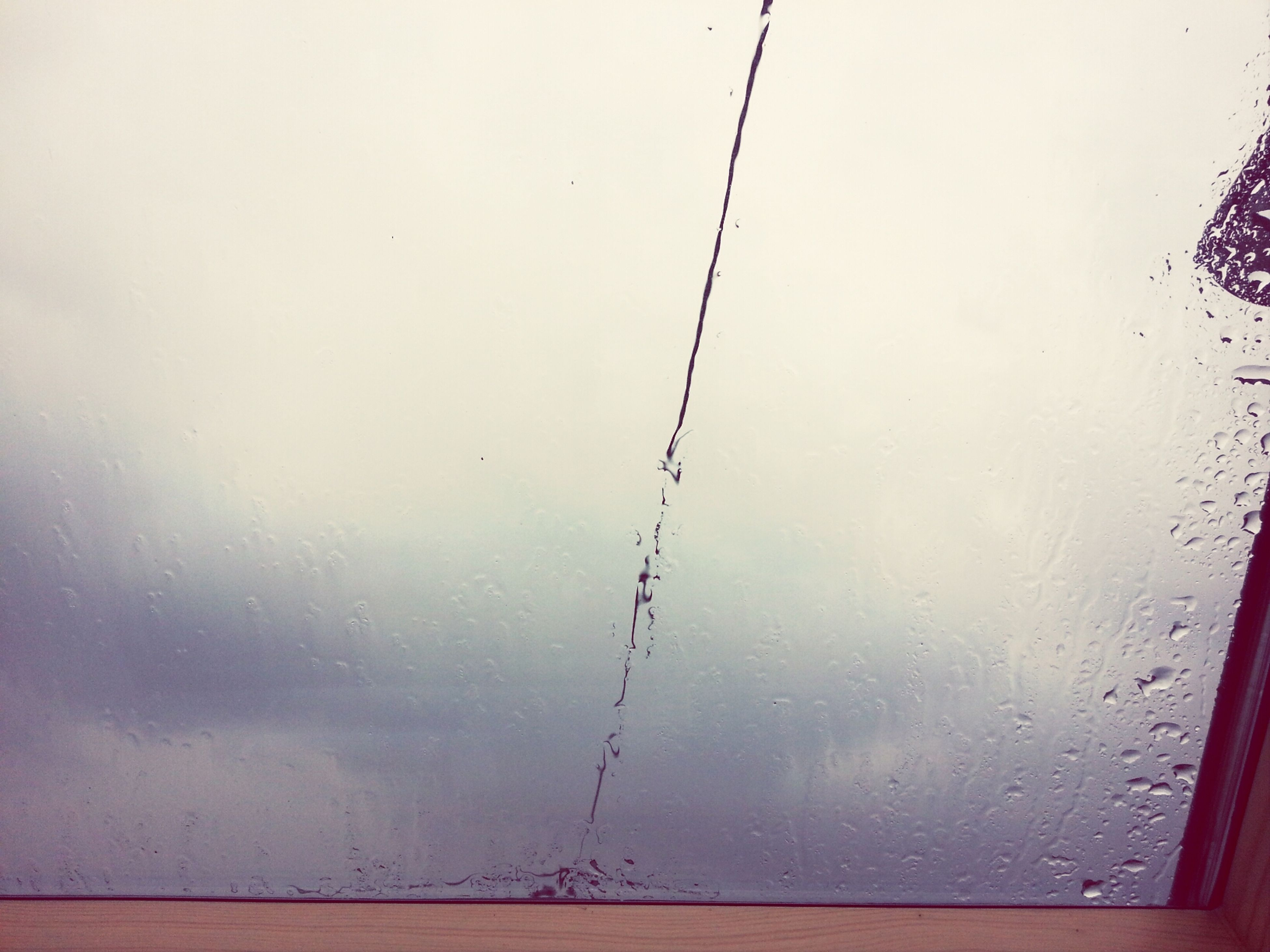 drop, window, water, wet, indoors, transparent, glass - material, rain, weather, season, raindrop, sky, glass, day, close-up, clear sky, nature, no people, looking through window, reflection