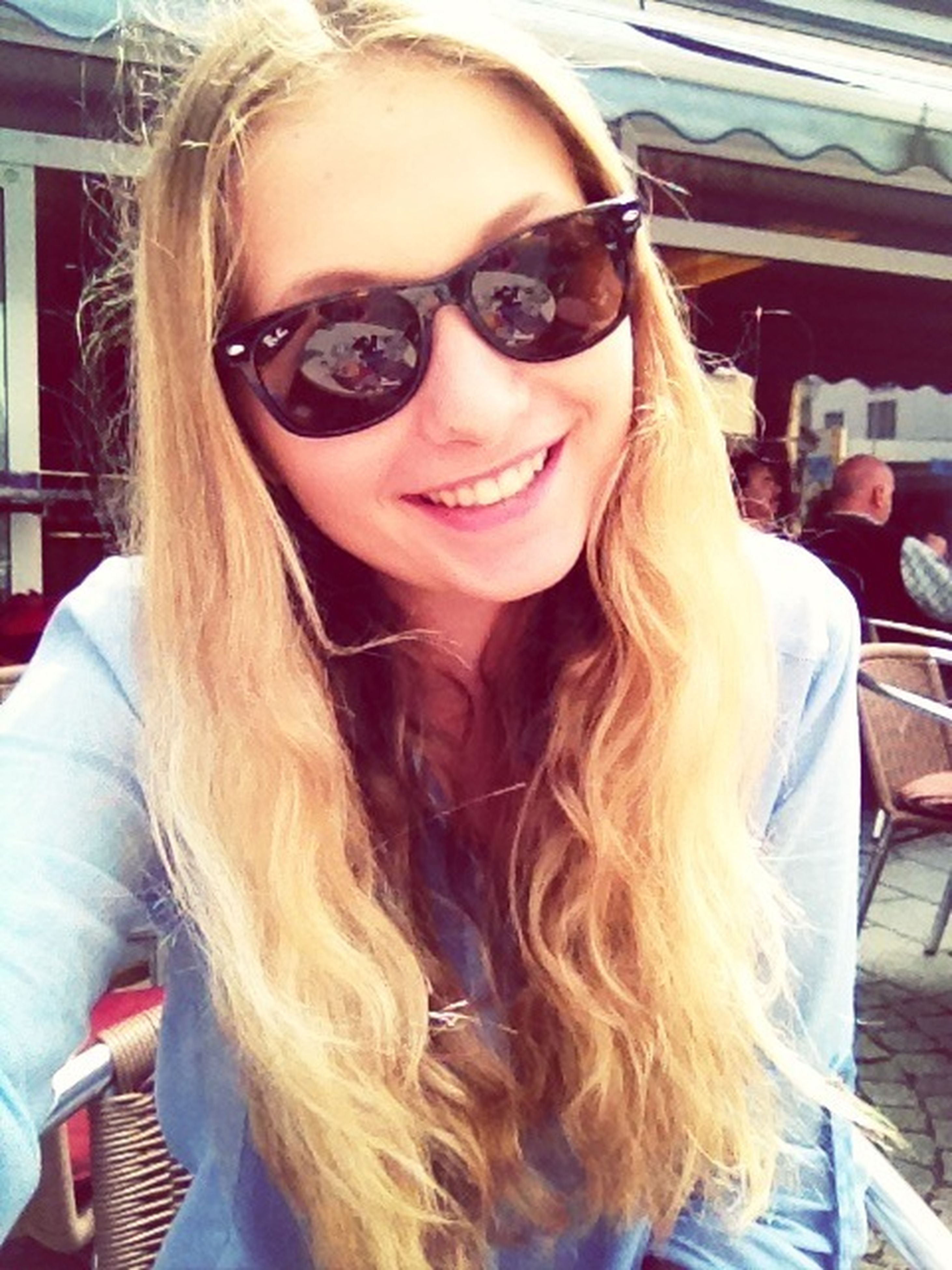 young adult, young women, portrait, looking at camera, person, long hair, lifestyles, sunglasses, front view, smiling, leisure activity, casual clothing, headshot, blond hair, toothy smile, indoors, happiness
