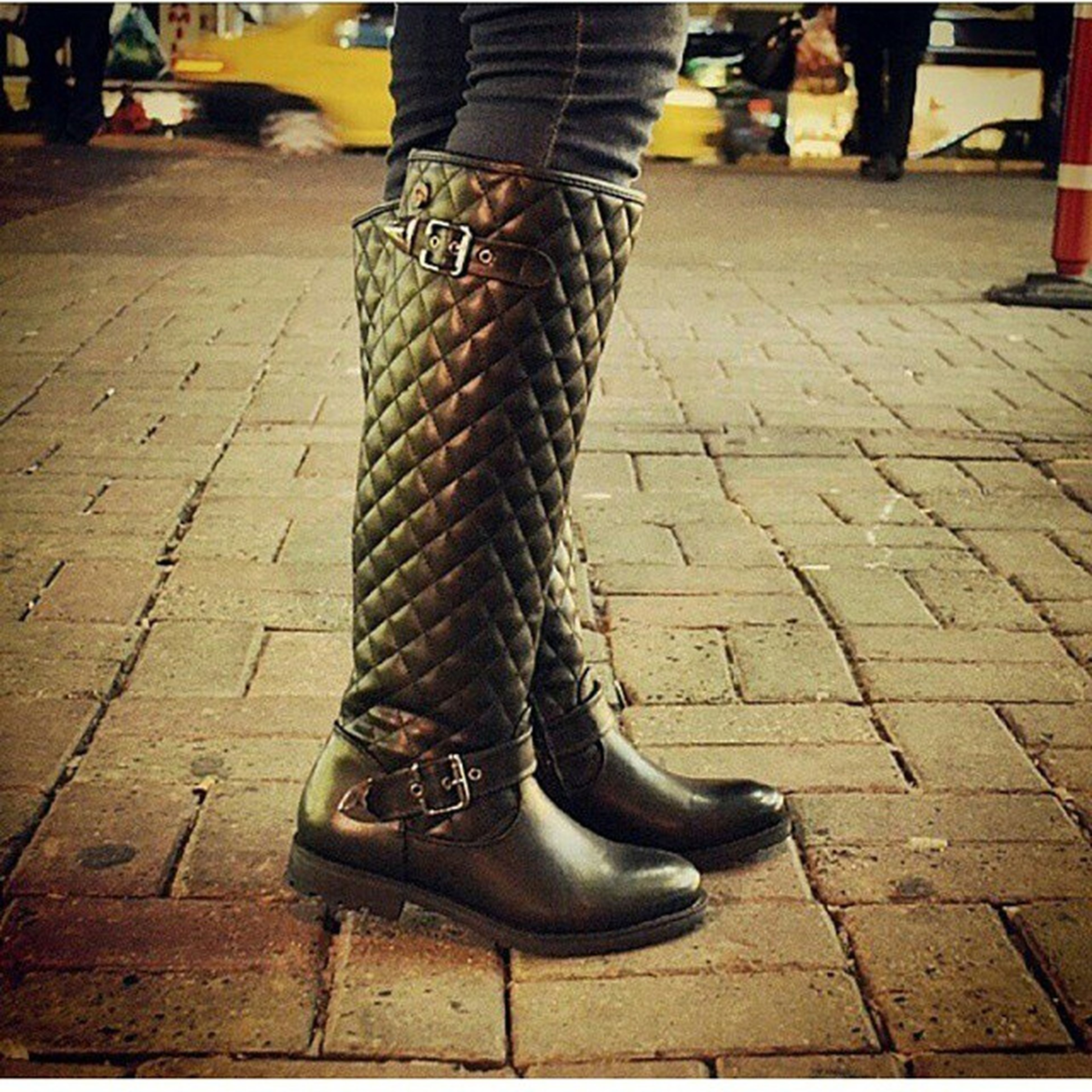 low section, person, shoe, street, footwear, human foot, standing, lifestyles, fashion, sidewalk, leisure activity, men, shadow, sitting, sunlight, outdoors