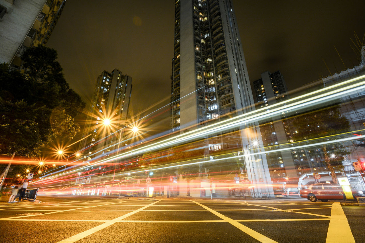 Shatin, Hong Kong, China - Long exposure with lighttrails of a bus. Architecture Artistic Built Structure High Building HongKong Lighttrails Lighttrailsphotography Longexposure Night Nightphotography No People Shatin Skyscraper Neighborhood Map