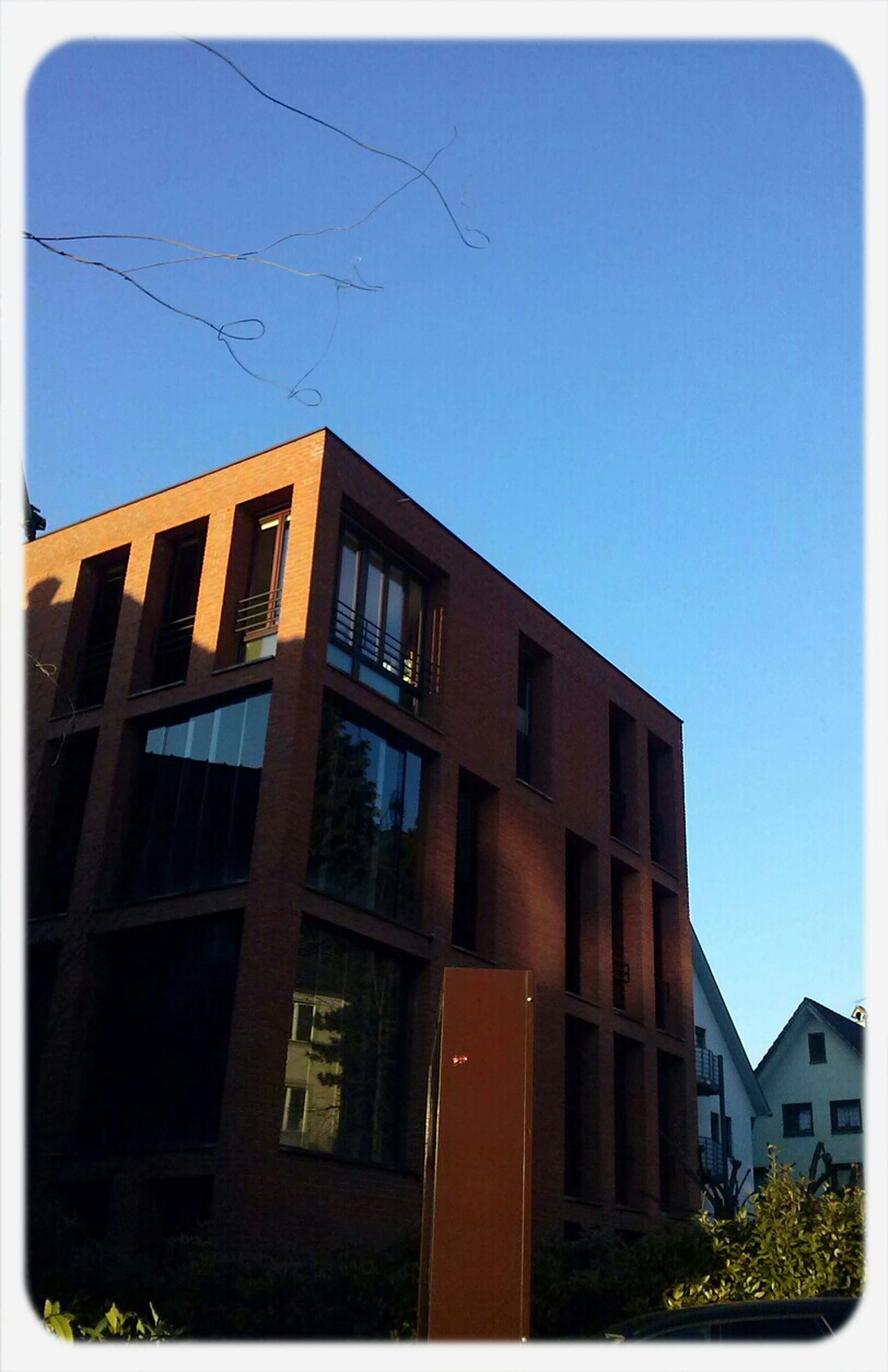 building exterior, architecture, built structure, low angle view, clear sky, window, residential building, residential structure, building, transfer print, blue, auto post production filter, house, city, day, outdoors, apartment, copy space, sky, no people