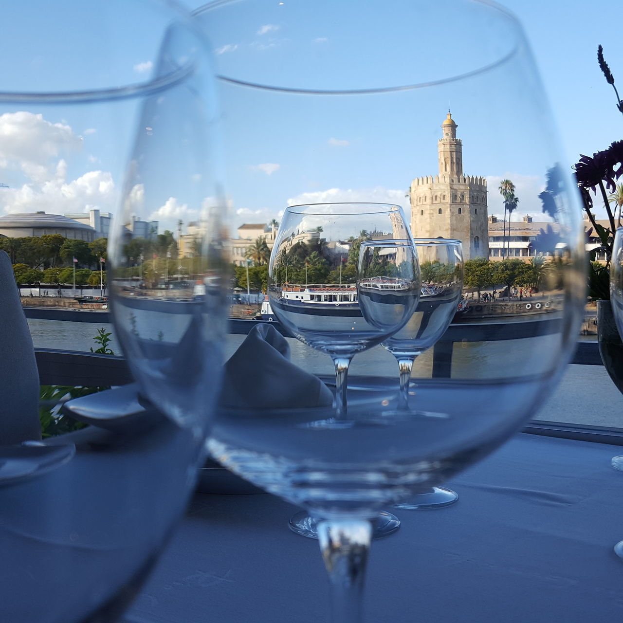 Wineglasses On Table Against Historic Building In City