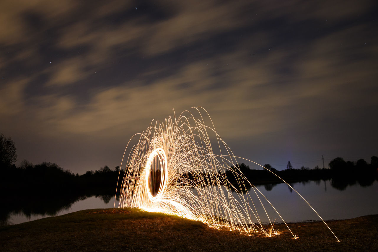 long exposure, night, motion, illuminated, wire wool, water, sky, no people, blurred motion, outdoors, nature, tree, scenics