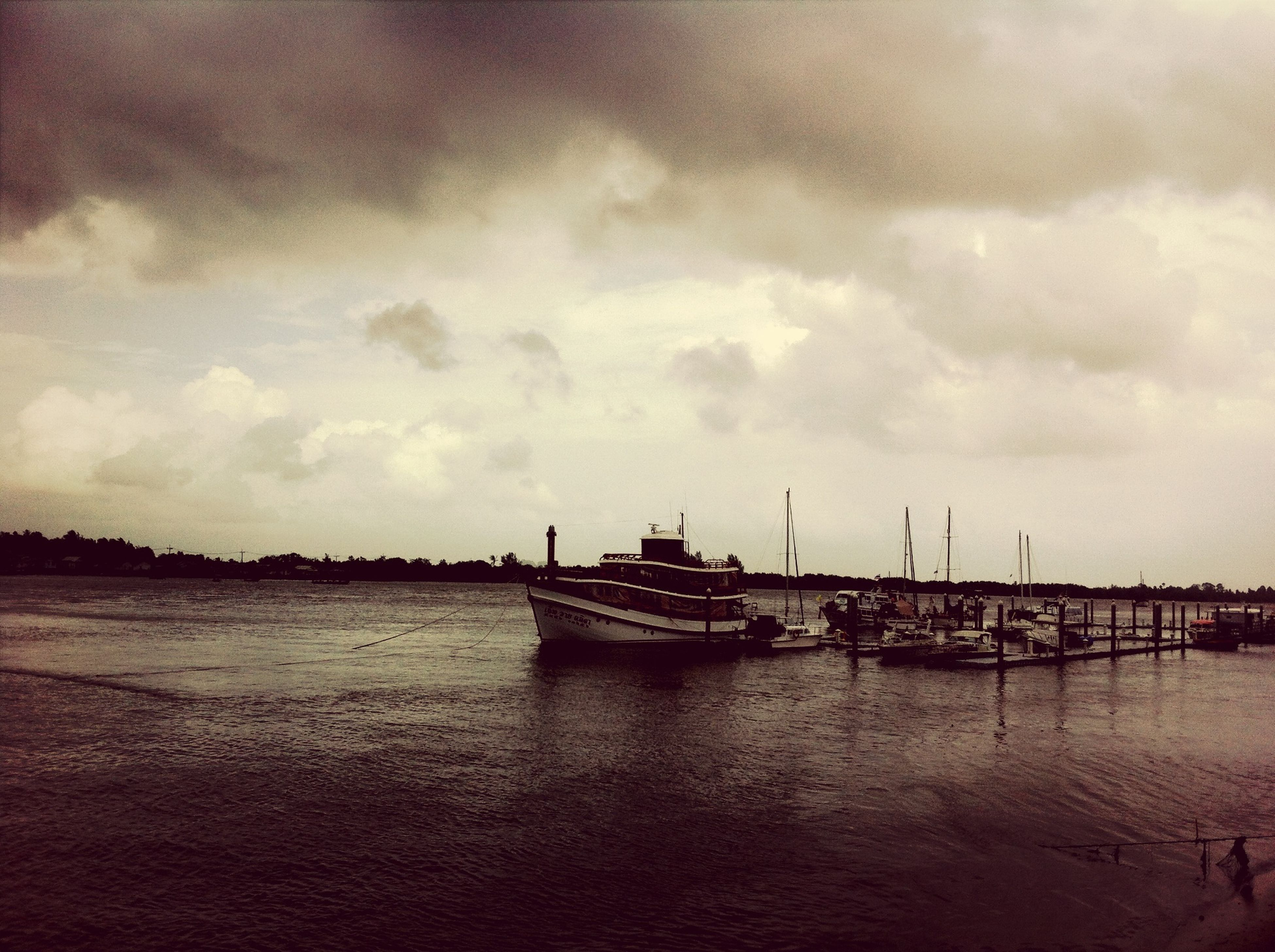 nautical vessel, transportation, mode of transport, water, boat, sky, moored, cloud - sky, sea, waterfront, cloudy, harbor, mast, nature, cloud, tranquility, overcast, tranquil scene, sailboat, ship