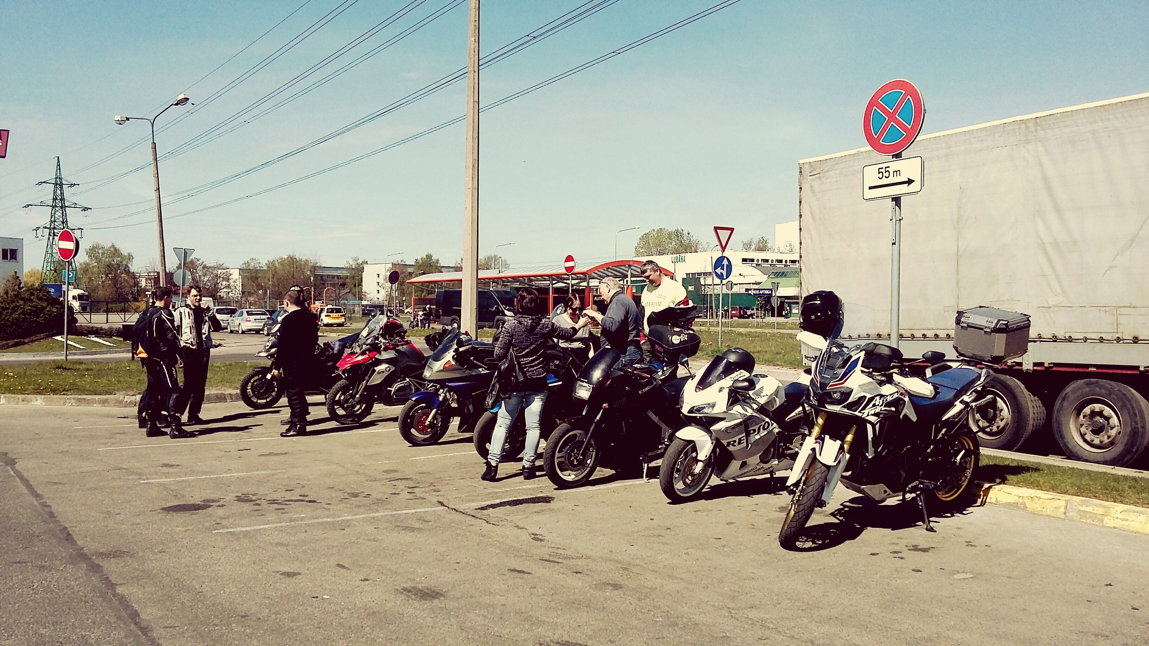 transportation, mode of transport, land vehicle, motorcycle, large group of people, real people, men, road, built structure, street, day, helmet, building exterior, outdoors, city, architecture, sky, biker, riot, people