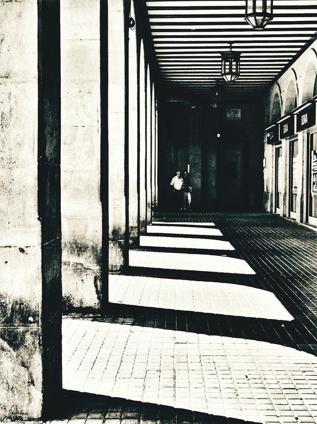 Lights & shadows Plaza del Castillo - Pamplona. Corridor Shadow Architecture Architectural Column AMPt_community NEM Submissions Bnw Photography Blackandwhite EyeEm Best Shots - Black + White