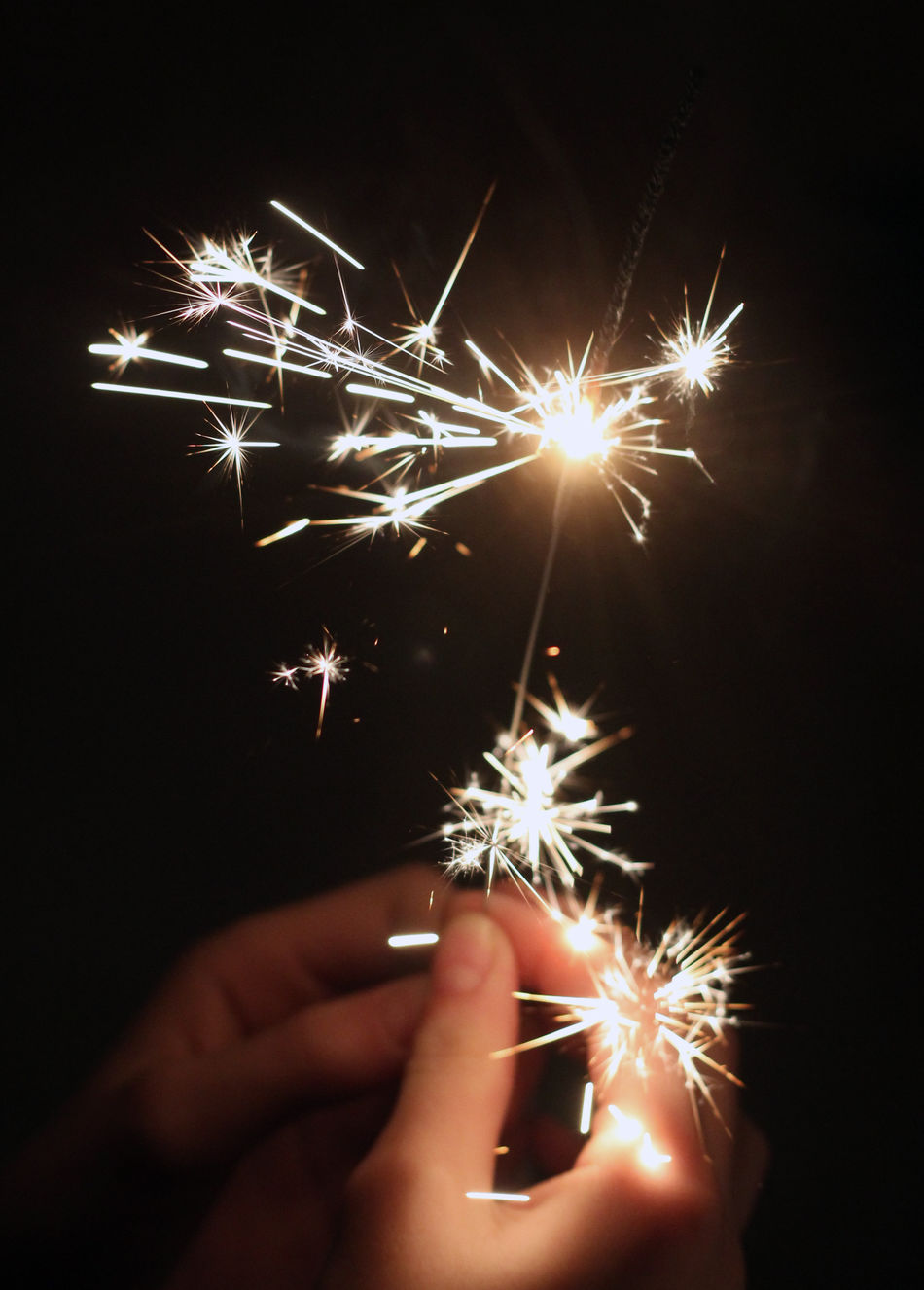 Sparkler in the dark Bright Dark Feiern Fingers Fire Fun Happy New Year Hell Dunkel Kontrast Jahreswechsel Lights New Year Party Party Time! Partying Ritual Stars Wunderkerze