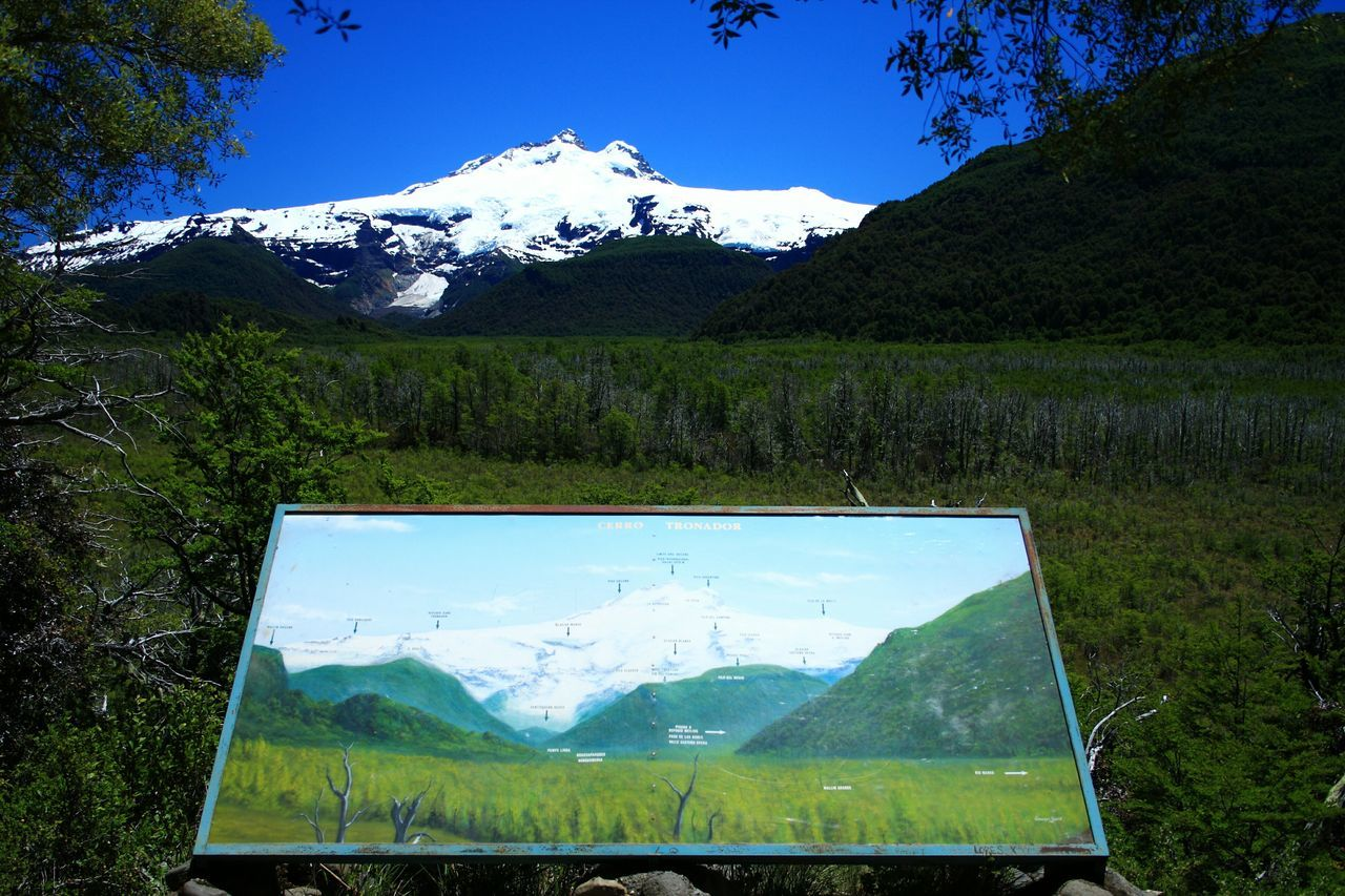 Cerro Tronador. Panoramic view from the road to. Bariloche, Patagonia Argentina. Tronador is an extinct stratovolcano in the southern Andes, located along the border between Argentina and Chile, near the Argentine city of Bariloche. The mountain was named Tronador (Spanish for Thunderer) by locals in reference to the sound of fallingseracs. With an altitude of 3,470 m, Tronador stands more than 1000 m above nearby mountains in the Andean massif, making it a popular mountaineering destination. Located inside two National Parks, Nahuel Huapi in Argentina and Vicente Pérez Rosales in Chile, Tronador hosts a total of eight glaciers, which are currently retreating due to warming of the upper troposphere. Unykaphoto Cerro Tronador Bariloche Patagonia Argentina Rio Negro Los Andes Cordillera De Los Andes Glacier Volcanoes