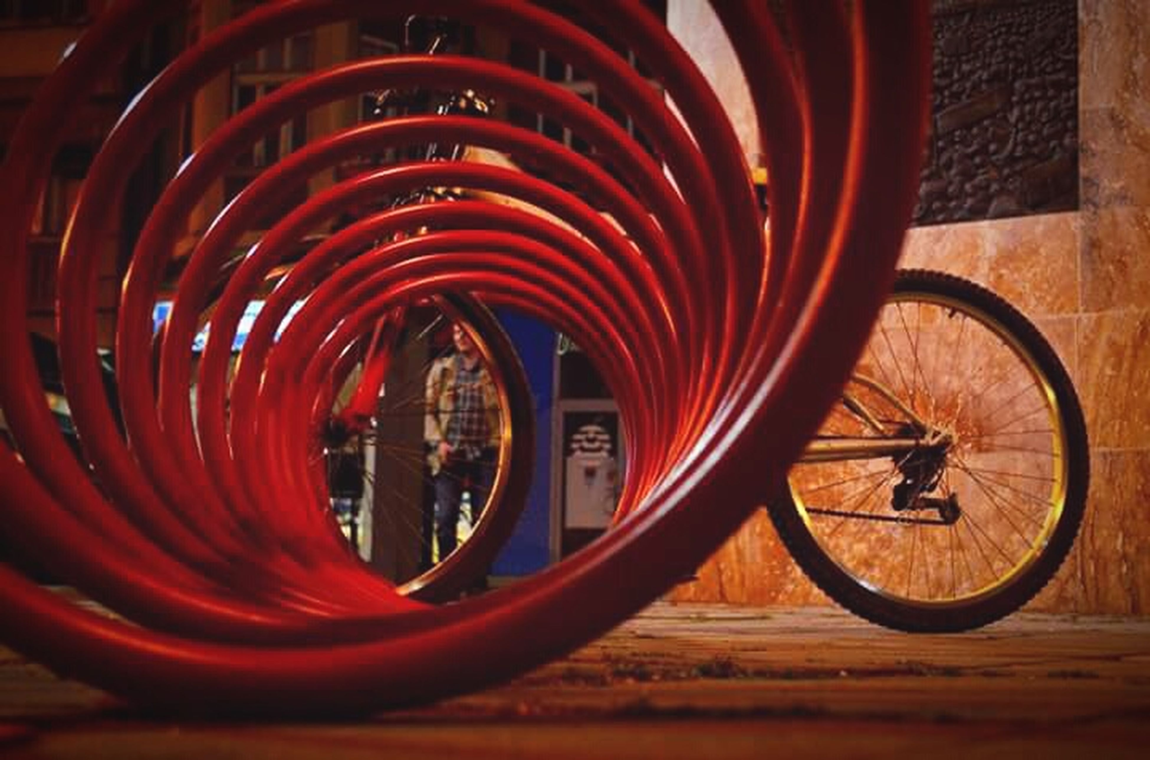 bicycle, transportation, mode of transport, land vehicle, stationary, red, wheel, parking, indoors, parked, no people, reflection, close-up, circle, day, travel, wall - building feature, built structure, window