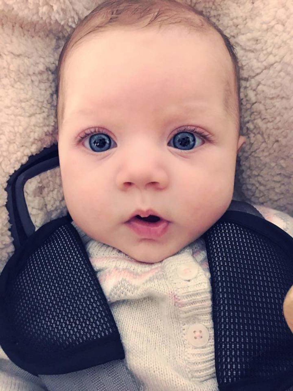 baby, looking at camera, babyhood, portrait, innocence, cute, babies only, childhood, indoors, close-up, one person, real people, sitting, human body part, day, people