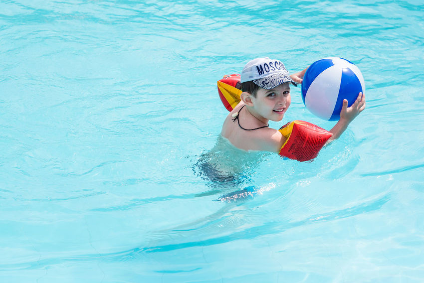 Trat, Thailand - May, 21, 2017 : Unidentified name Boys swimsuit floating and playing with ball in the swimming pool at Klong Prao Resort in Prao Beach Koh Chang island Trat, Thailand. Childhood Day Editorial  Happiness Headwear Illustrative Illustrative Editorial Inflatable Ring Leisure Activity Lifestyles One Person Outdoors Real People Smiling Sport Summer Swimming Swimming Goggles Swimming Pool Thailand Vacations Water Waterfront Young Adult Young Women