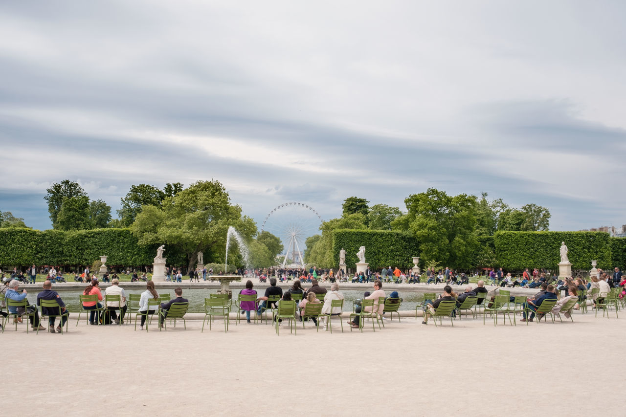 Beauty In Nature Cloud - Sky Copy Space Day Enjoying Life Enjoyment Ferris Wheel Fountain Garden Green Color Jardin Des Tuileries Large Group Of People Nature Outdoors People Public Park Relaxation Sitting Sky Tourism Travel Tree Watching Water