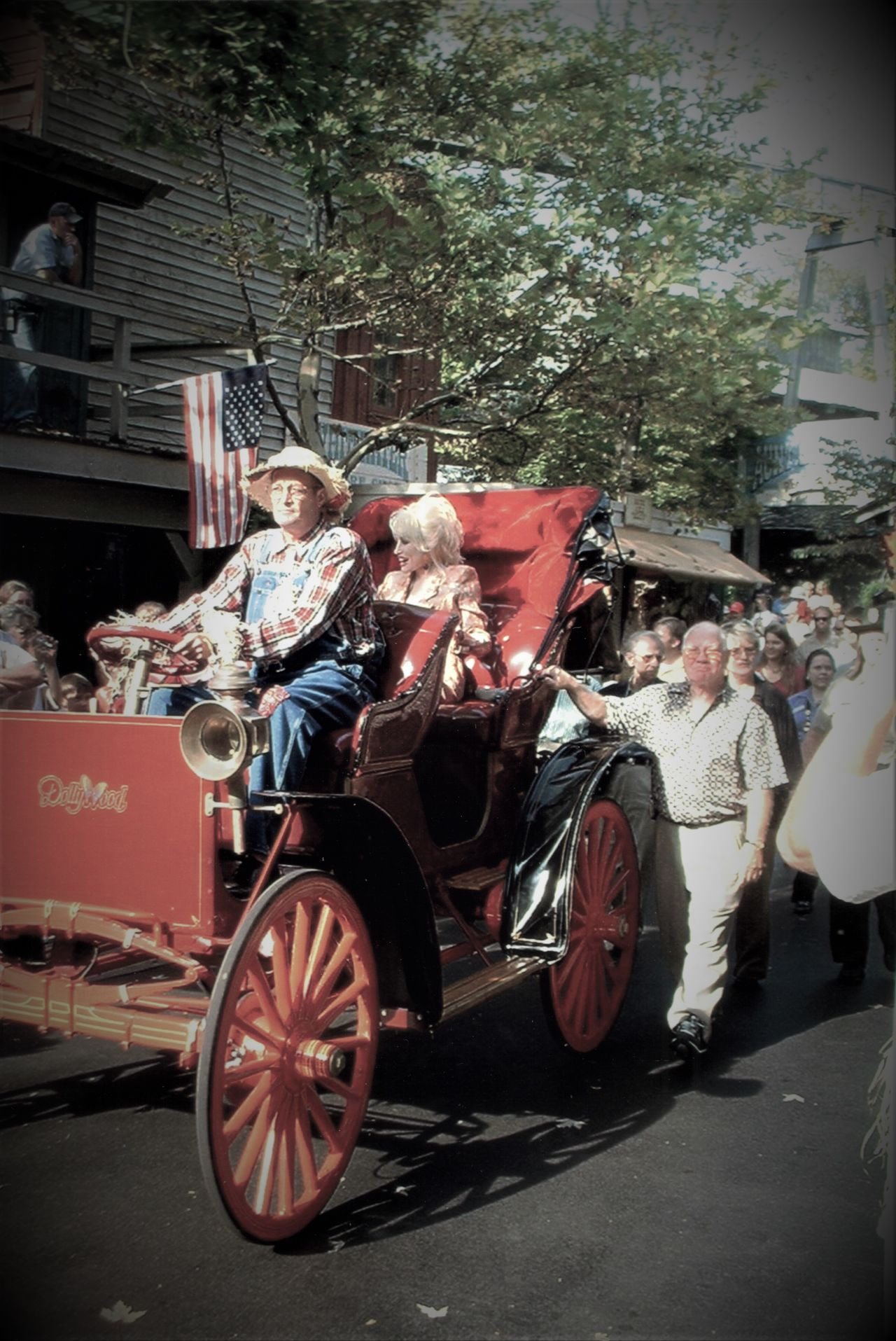 Miss Dolly Parton in her Horseless Carriage at Dollywood, Pigeon Forge, TN 2004 2004 Actress Amusement Parks Celebrity Day Dolly Parton Dollywood Horselesscarriage Land Vehicle Mode Of Transport Outdoors Singer  Wheel