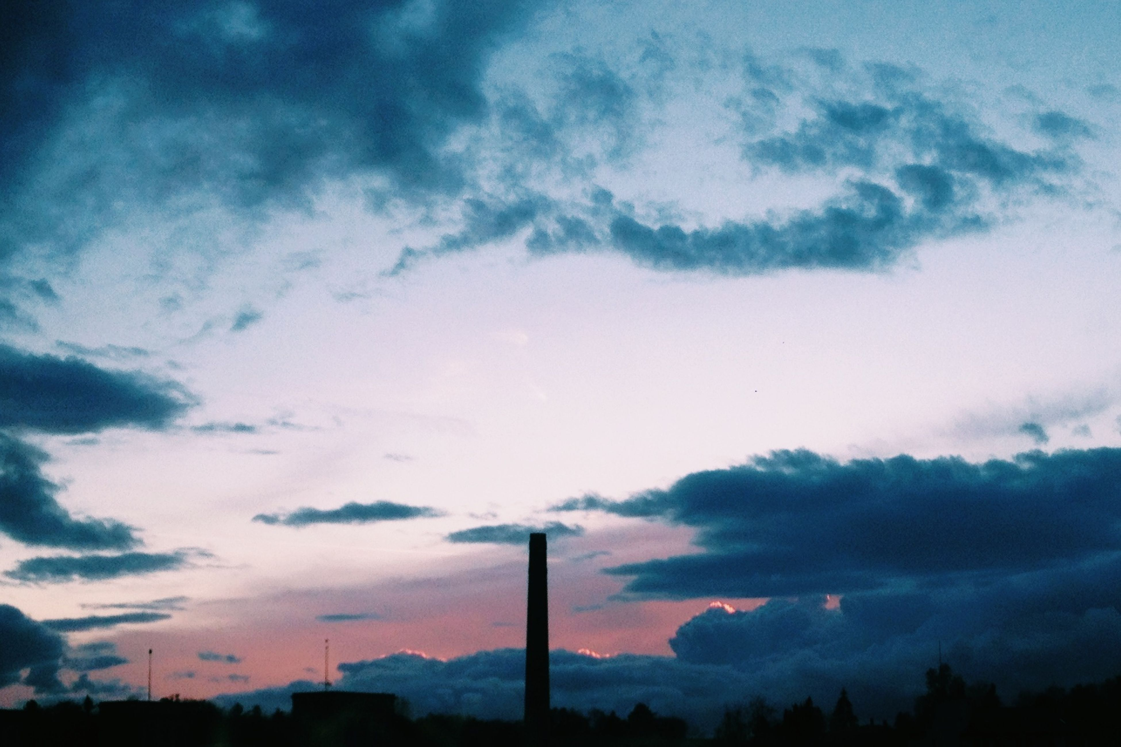 sky, silhouette, low angle view, cloud - sky, cloudy, cloud, sunset, beauty in nature, nature, tranquility, street light, built structure, scenics, electricity pylon, dusk, outdoors, no people, pole, tranquil scene, fuel and power generation